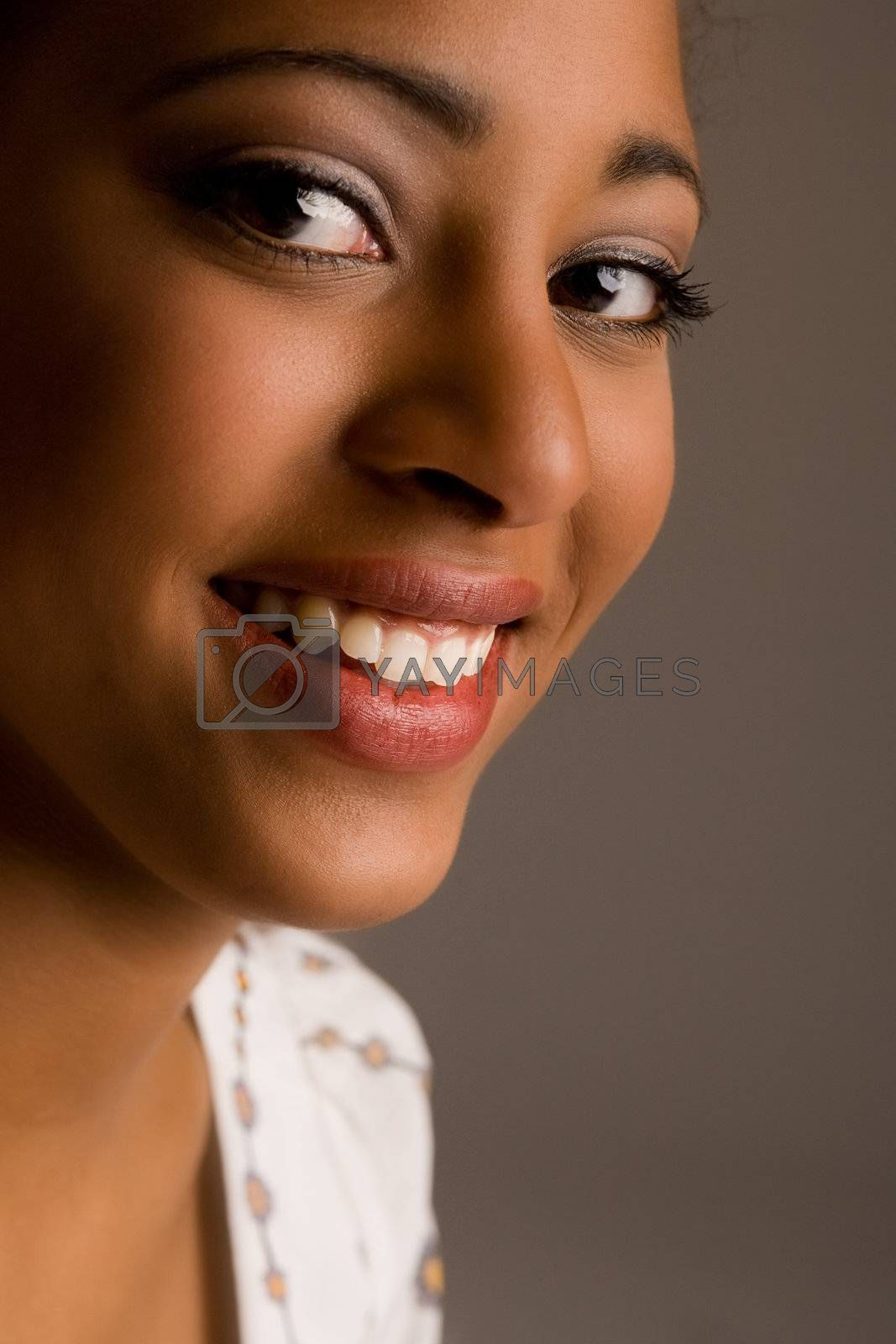 African girl in the studio with a smiling face