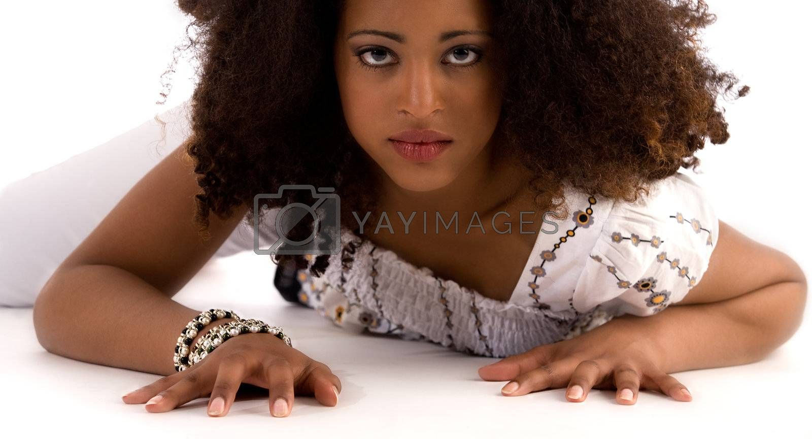 Young african girl is crawling to the lens