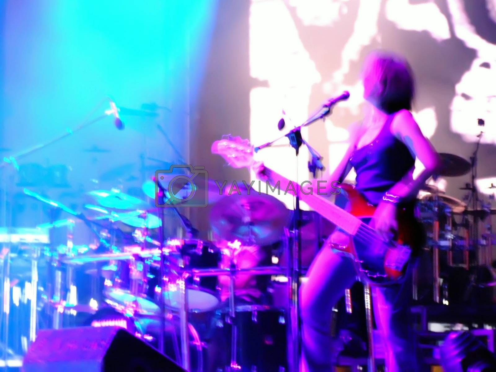 Rock guitarist in dim stage lights during rock concert in Malta, blurred