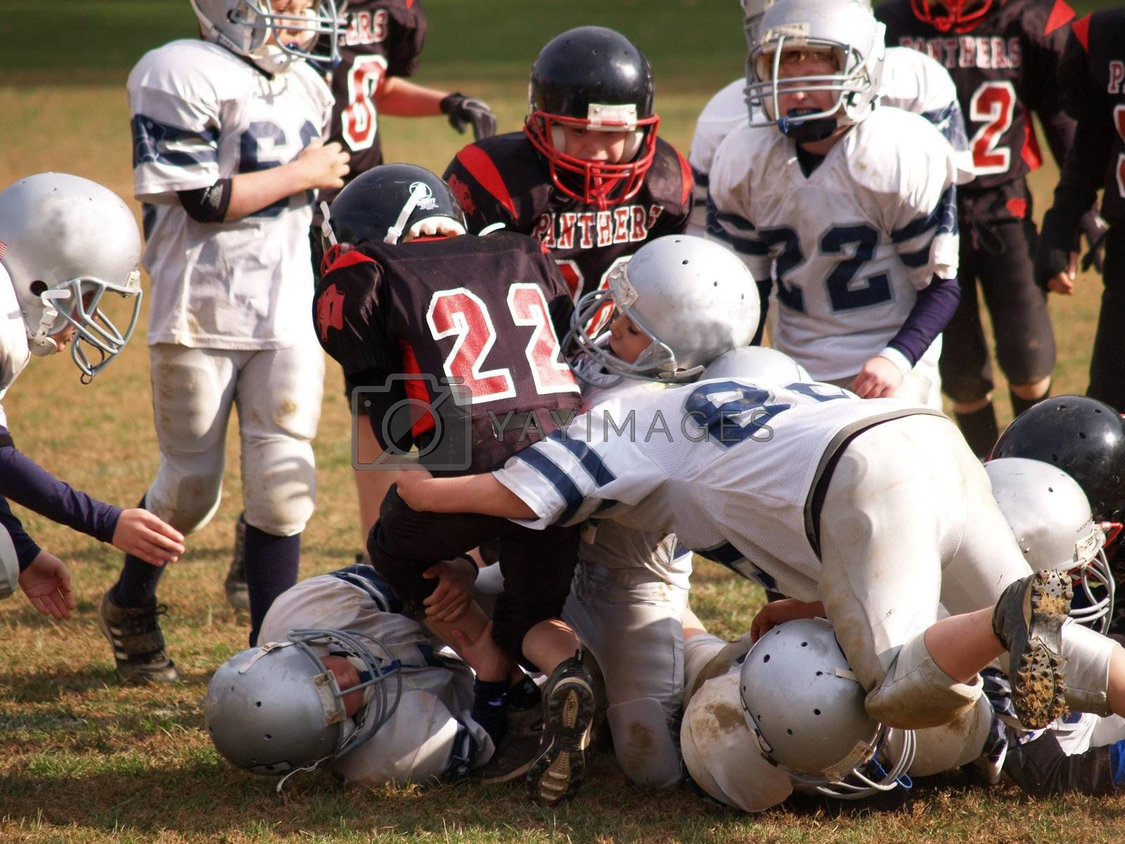 young American football team tackling