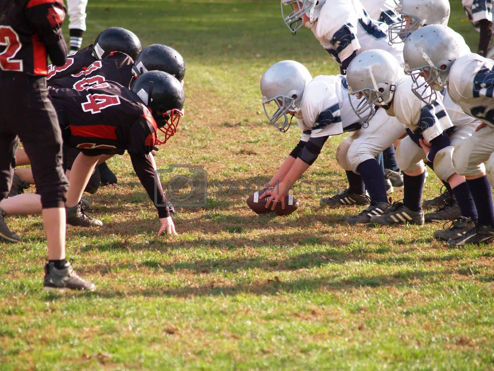 young American football team at the line of scrimmage