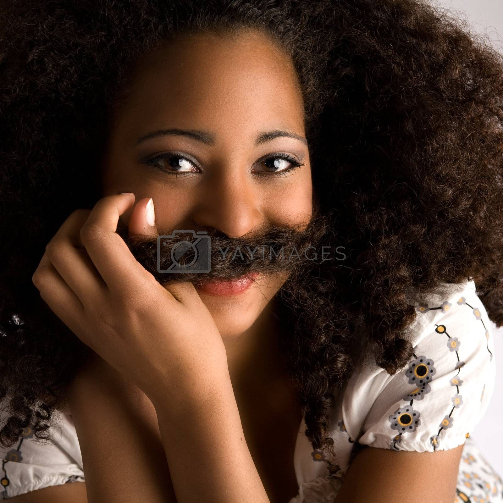 Young cute african woman looking into the lens