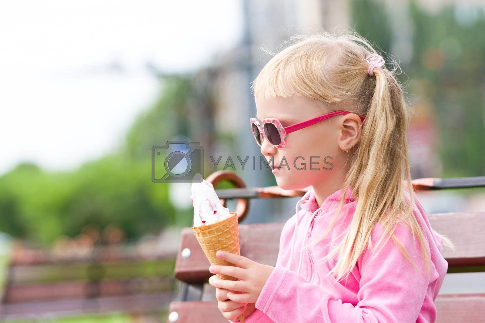 Royalty free image of Little girl eating icecream Little girl eating icecream by Bedolaga