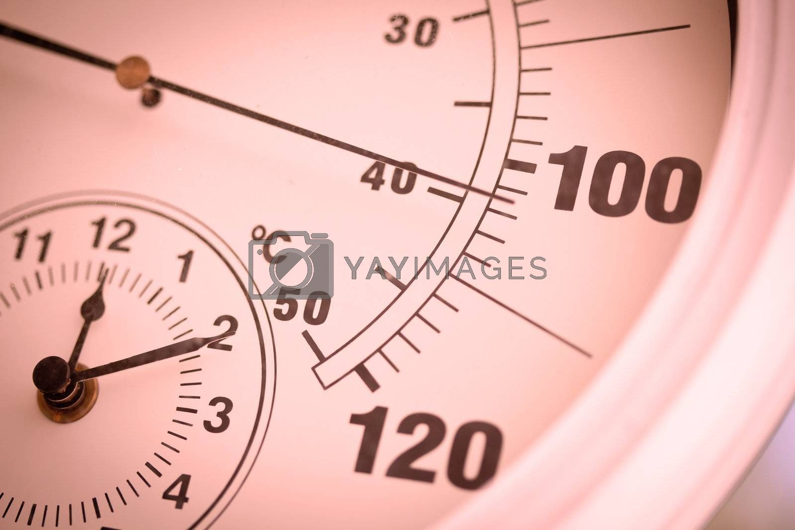Royalty free image of Colorized Round Thermometer Showing Over 100 Degrees by Feverpitched