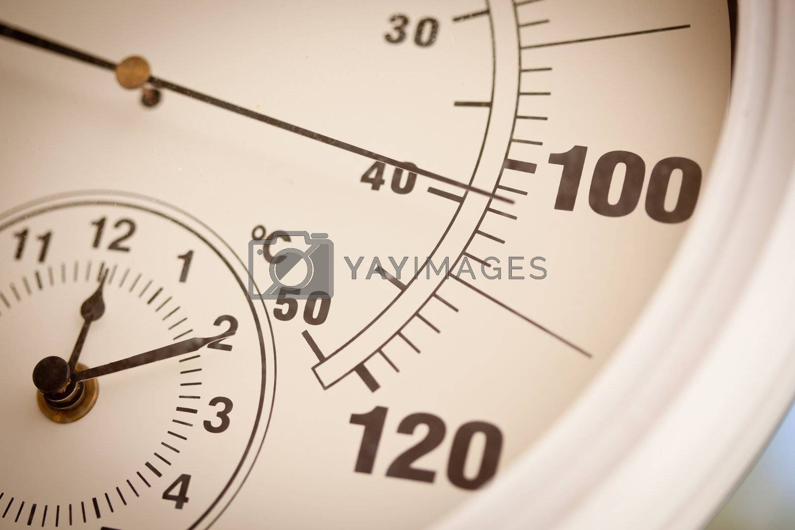 Royalty free image of Round Thermometer Showing Over 100 Degrees by Feverpitched