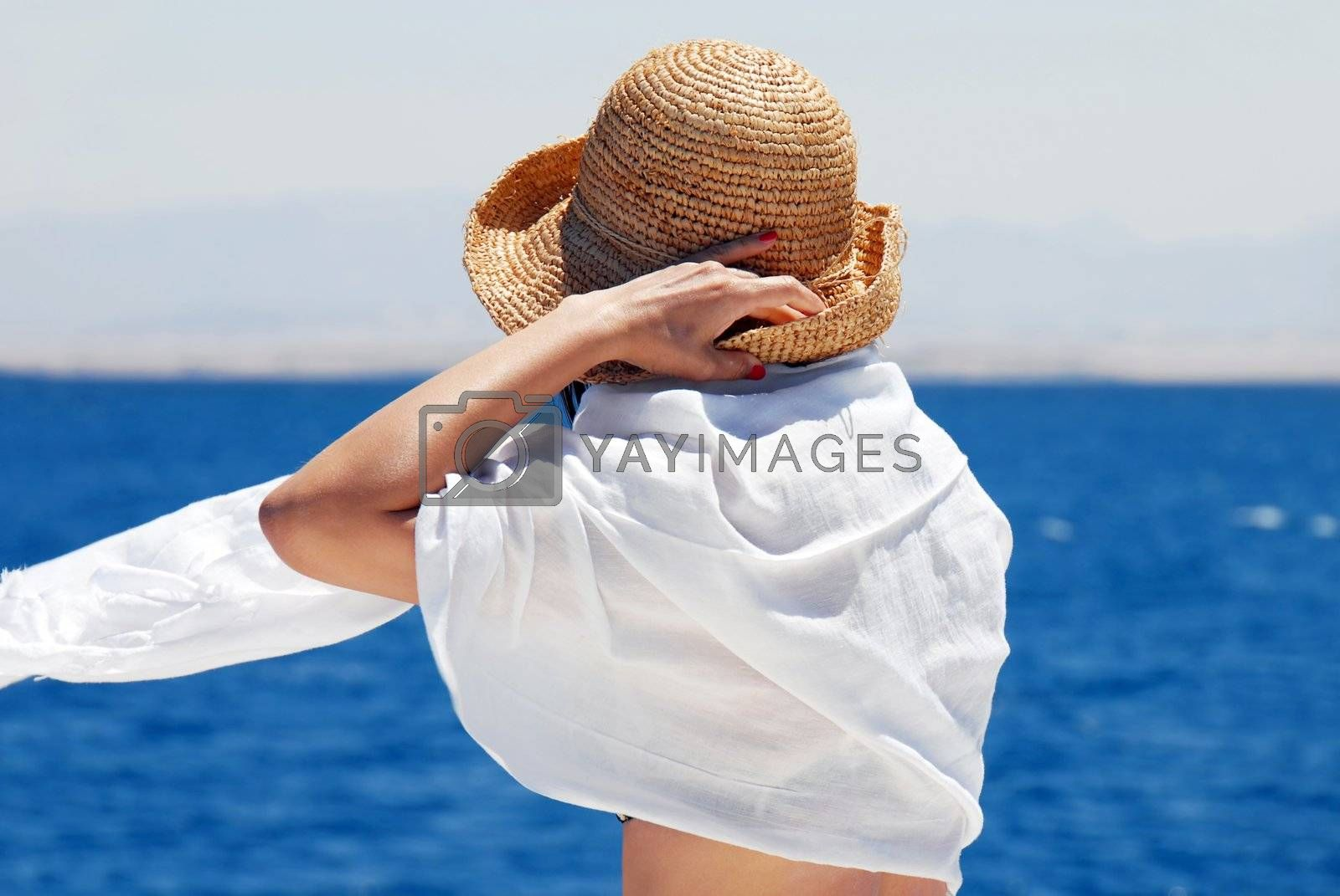 Royalty free image of Woman on seaside by simply