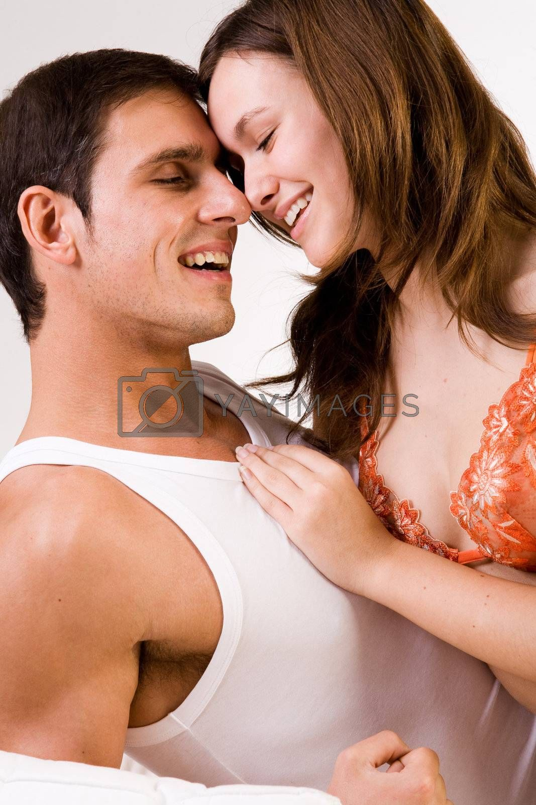 Young adult couple in the studio smiling