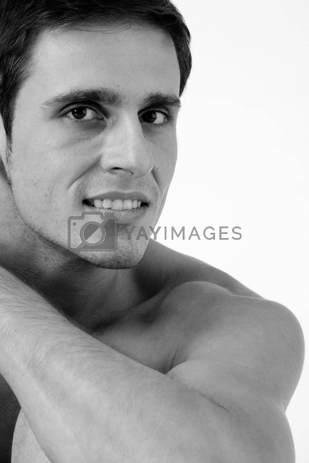 Young man portrait in the studio on a white background