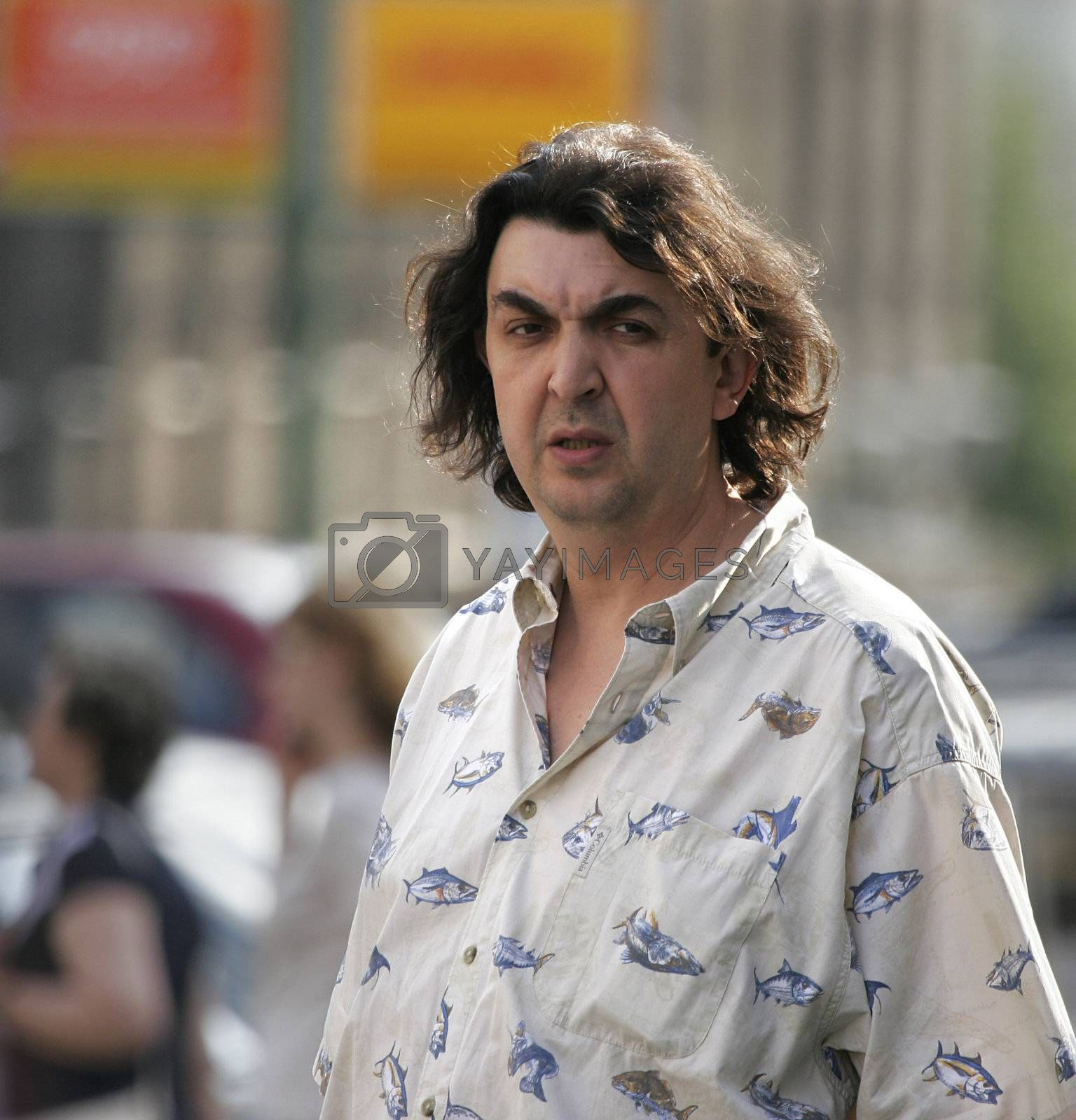 MOSCOW, RUSSIA - JUNE 26, 2006: Russian actor Igor Zolotovitsky casually embodied in the street Moscow.  June 26, 2006. Moscow