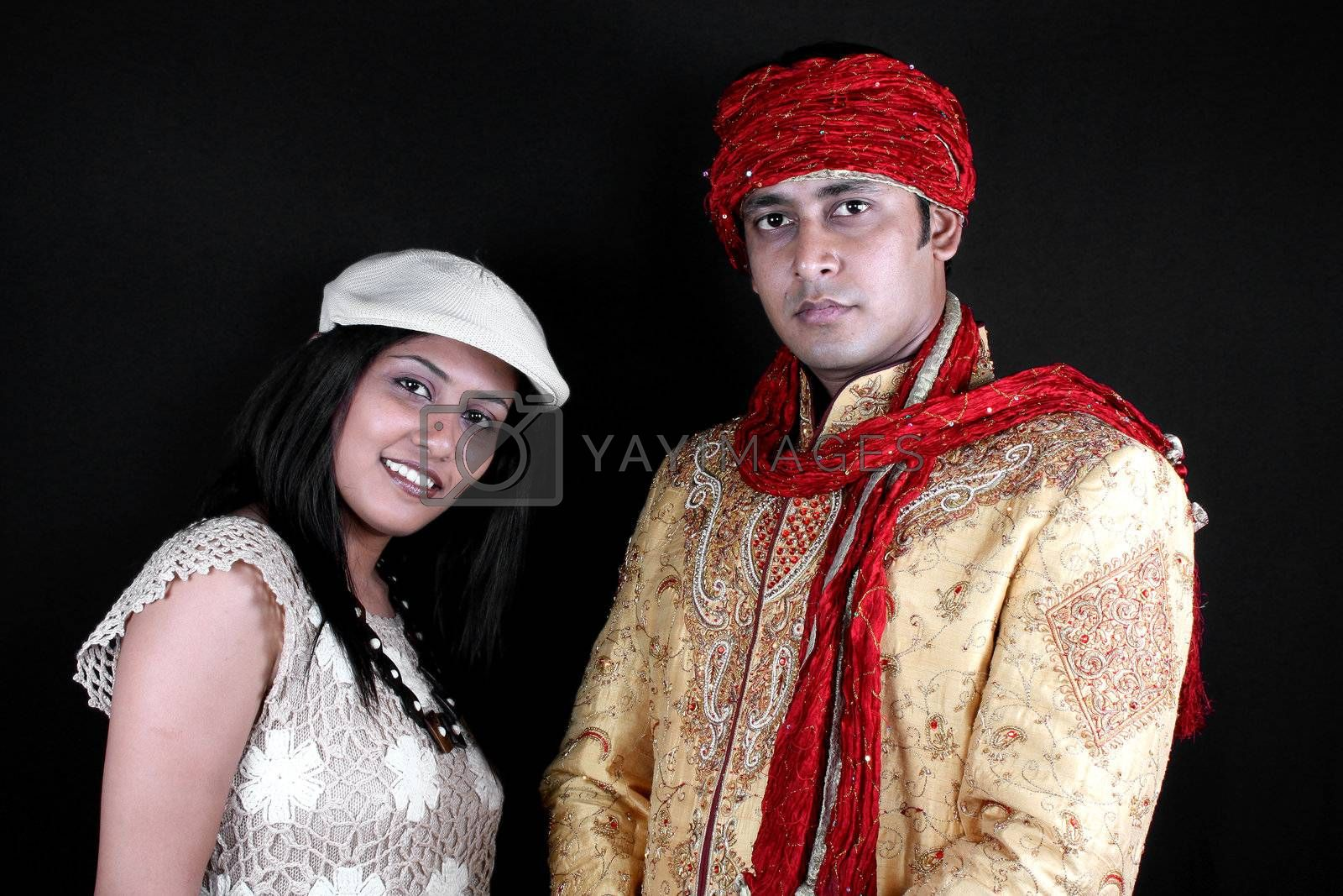 A young Indian man and woman wearing clothes of diverse fashion.