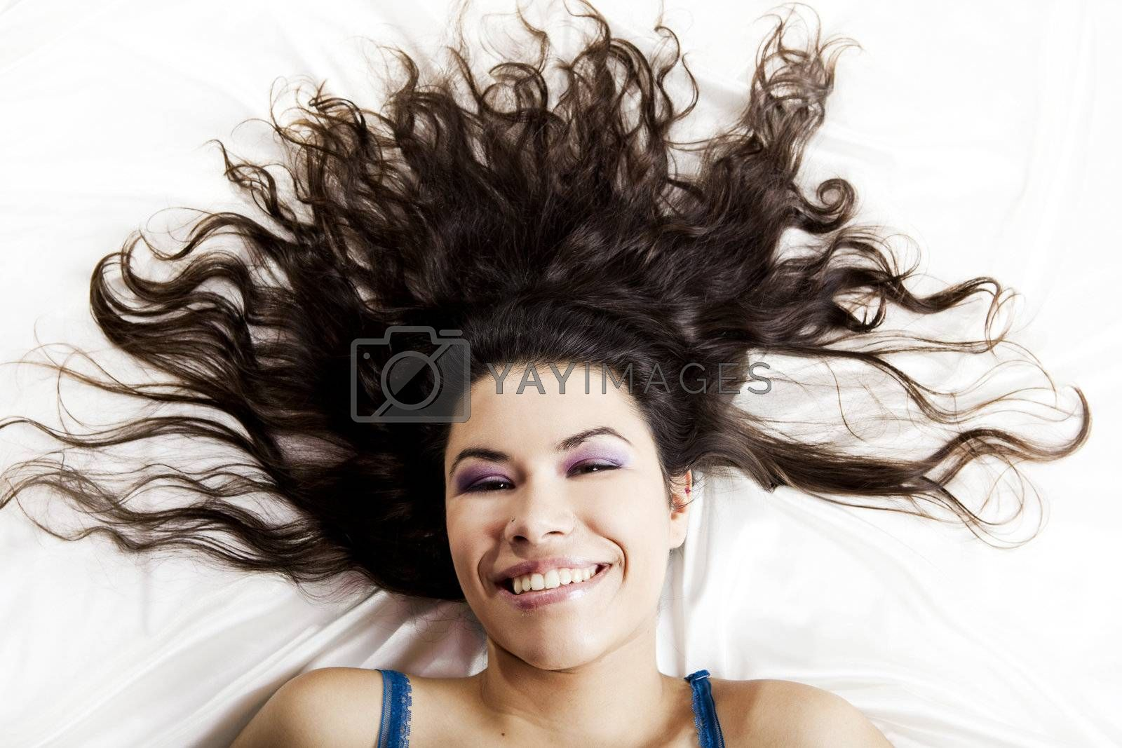 Top view portrait of a beautiful young woman smiling