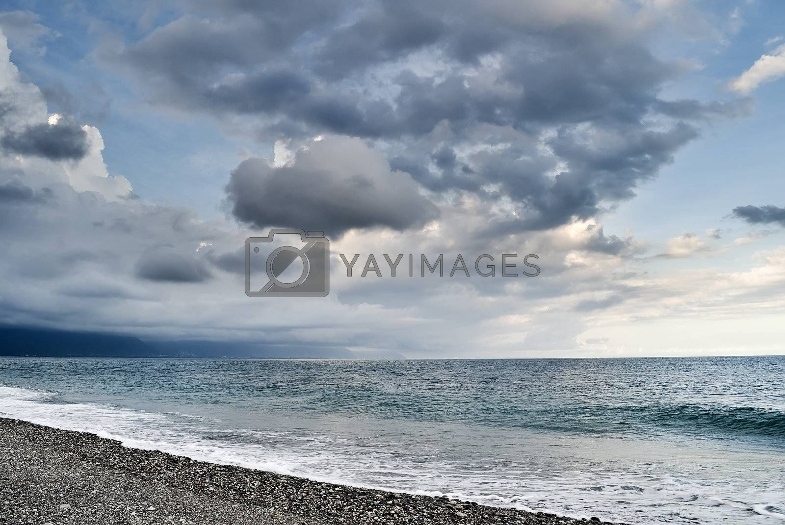 Bad weather seascape with cloudy sky and water wave.