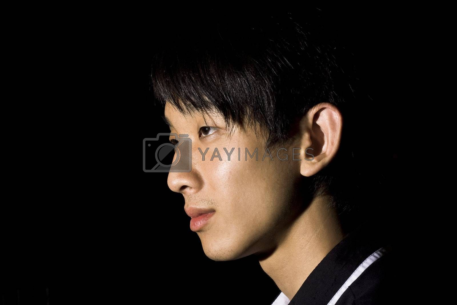 Portrait of an Asian man in the darkness  by cozyta