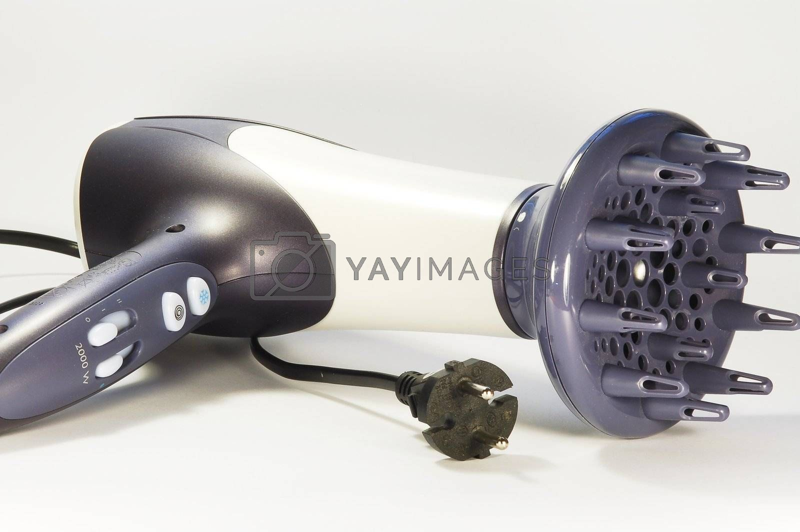 Close view of a two-colored hair drier with a wire