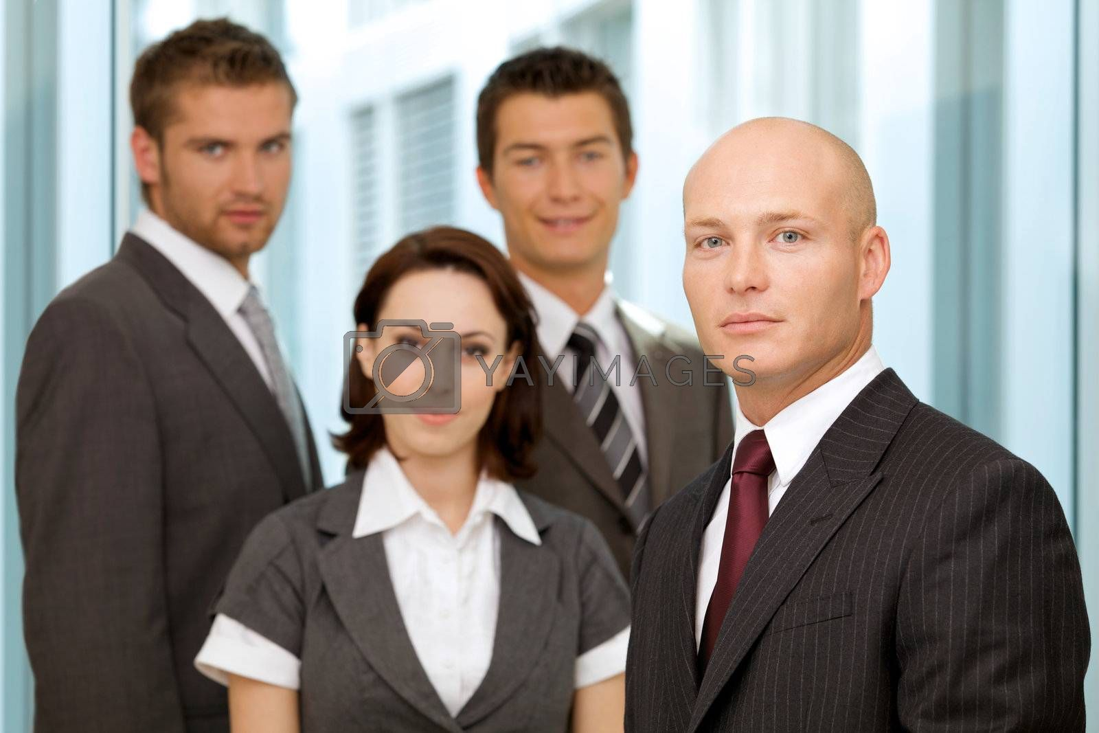 Portrait of young caucasian business people in office