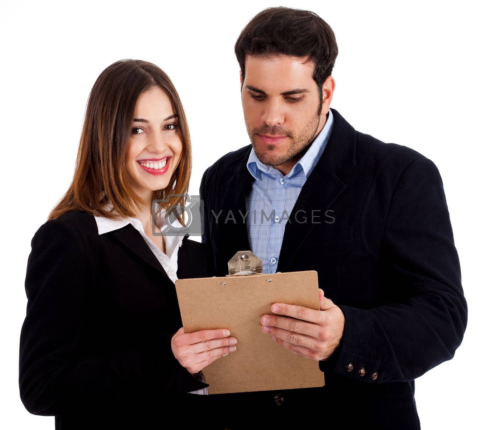 Front view of male and female colleagues holding notepad and discussing against white isolated background