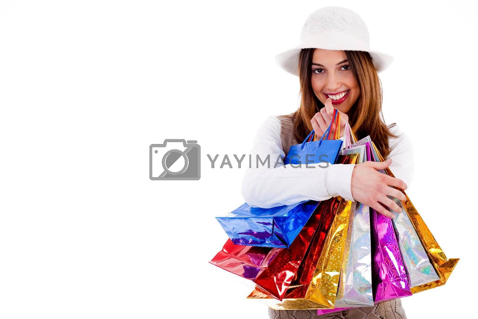 Portrait of Young lady happy with lot of shopping bags on a isolated background