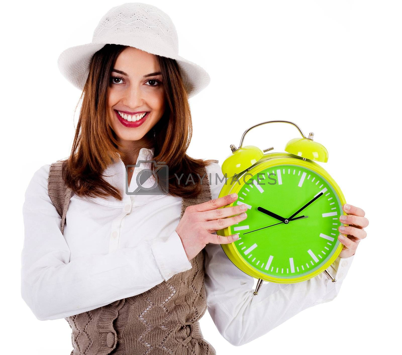 Portrait of stylish lady holding alarm clock on an isolated background