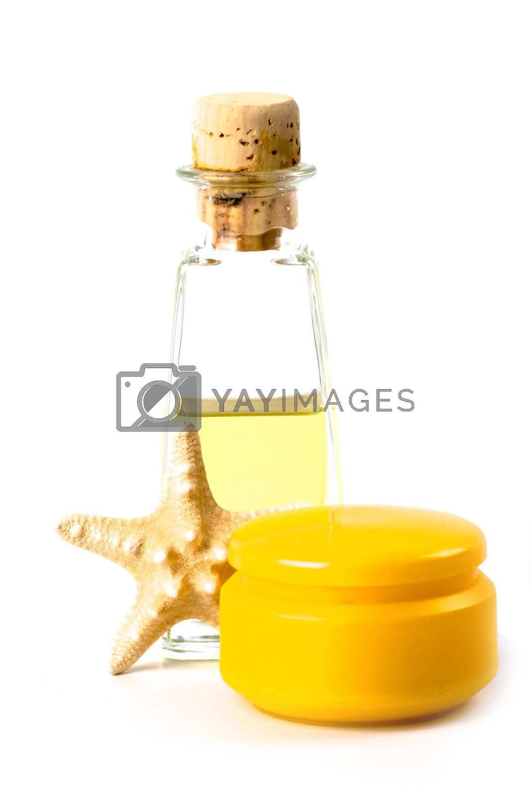 spa products: sea salt, facial creme, oil and star isolated on white background