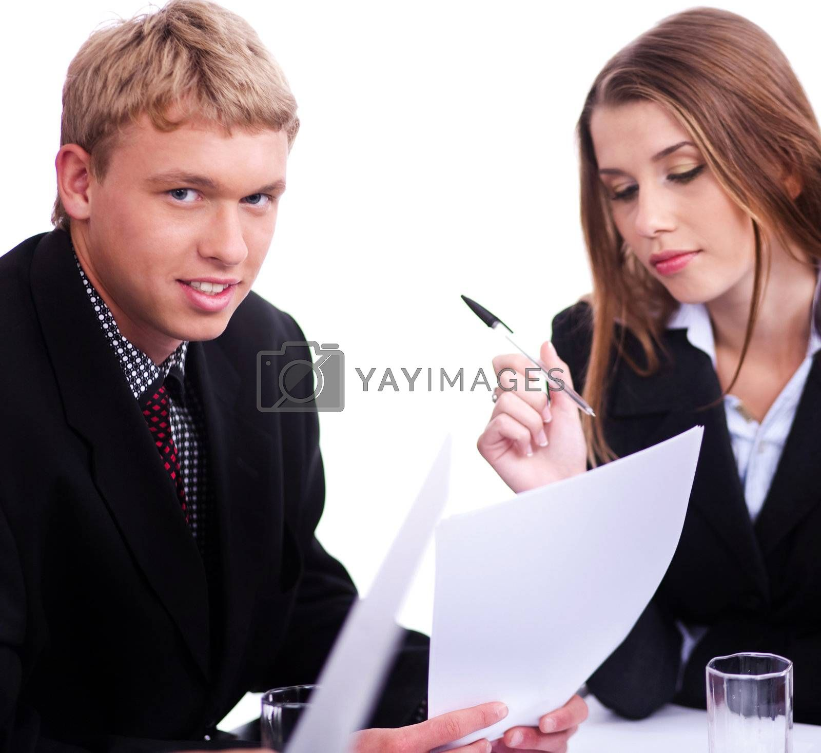 Young confident businessman with his collegue looking at camera over white background