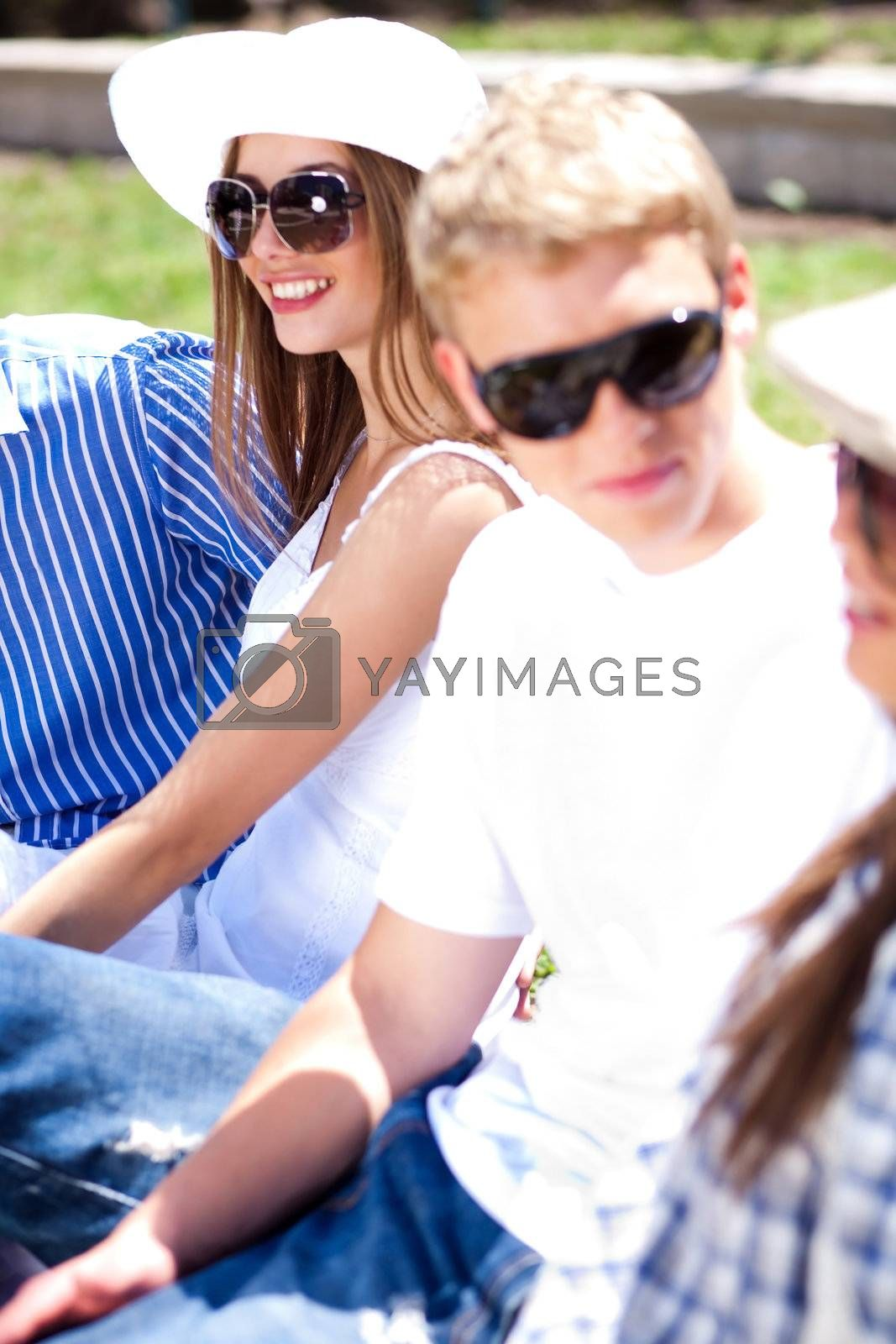 The goggles group, friends relaxing on sunny day and enjoying outdoors