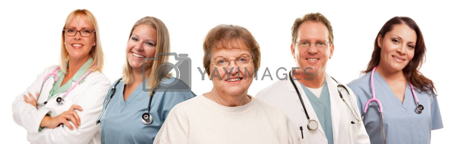 Smiling Senior Woman with Medical Doctors and Nurses Behind Isolated on a White Background.
