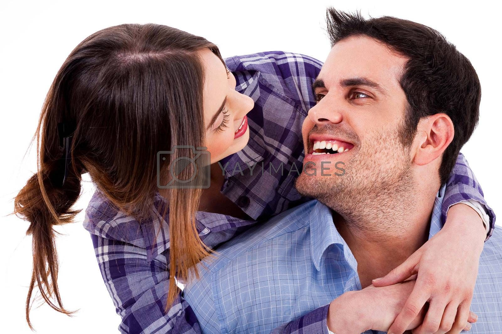Closeup portrait of a cute young woman hugging her husband from behind