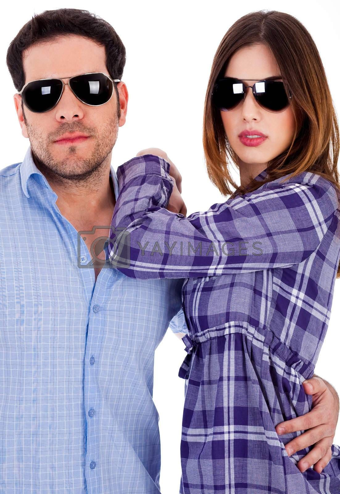 potrait of young couple posing in style with sunglasses