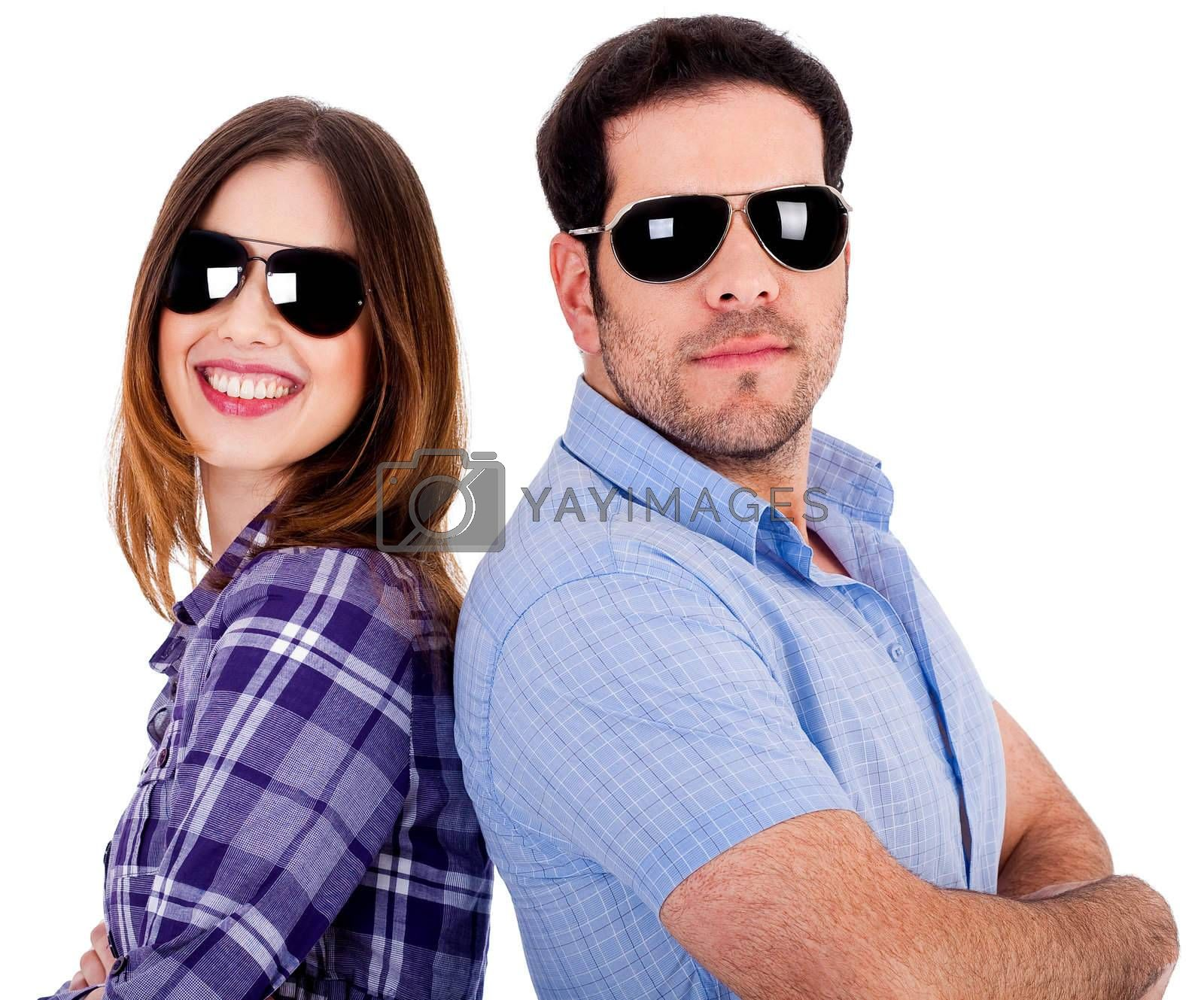 closeup of couple wearing sunglasses standing back to back