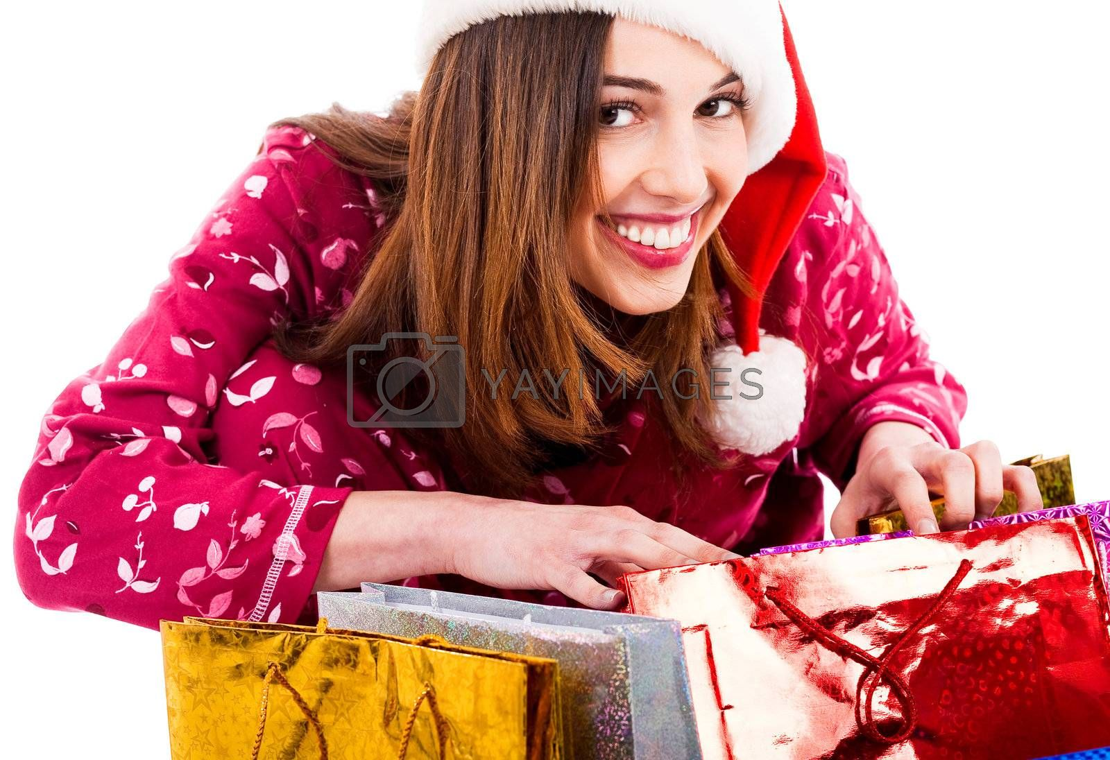 portrait of young lady opening christmas gift bags and smiling at camera