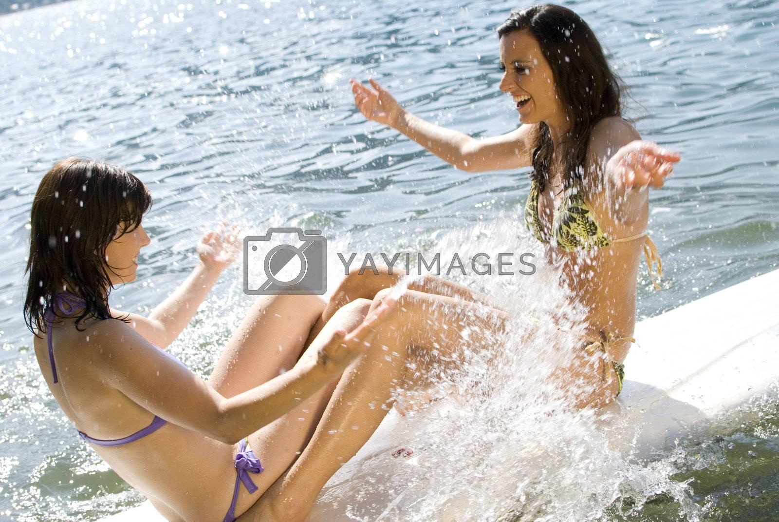 Girls having fun on surfboard