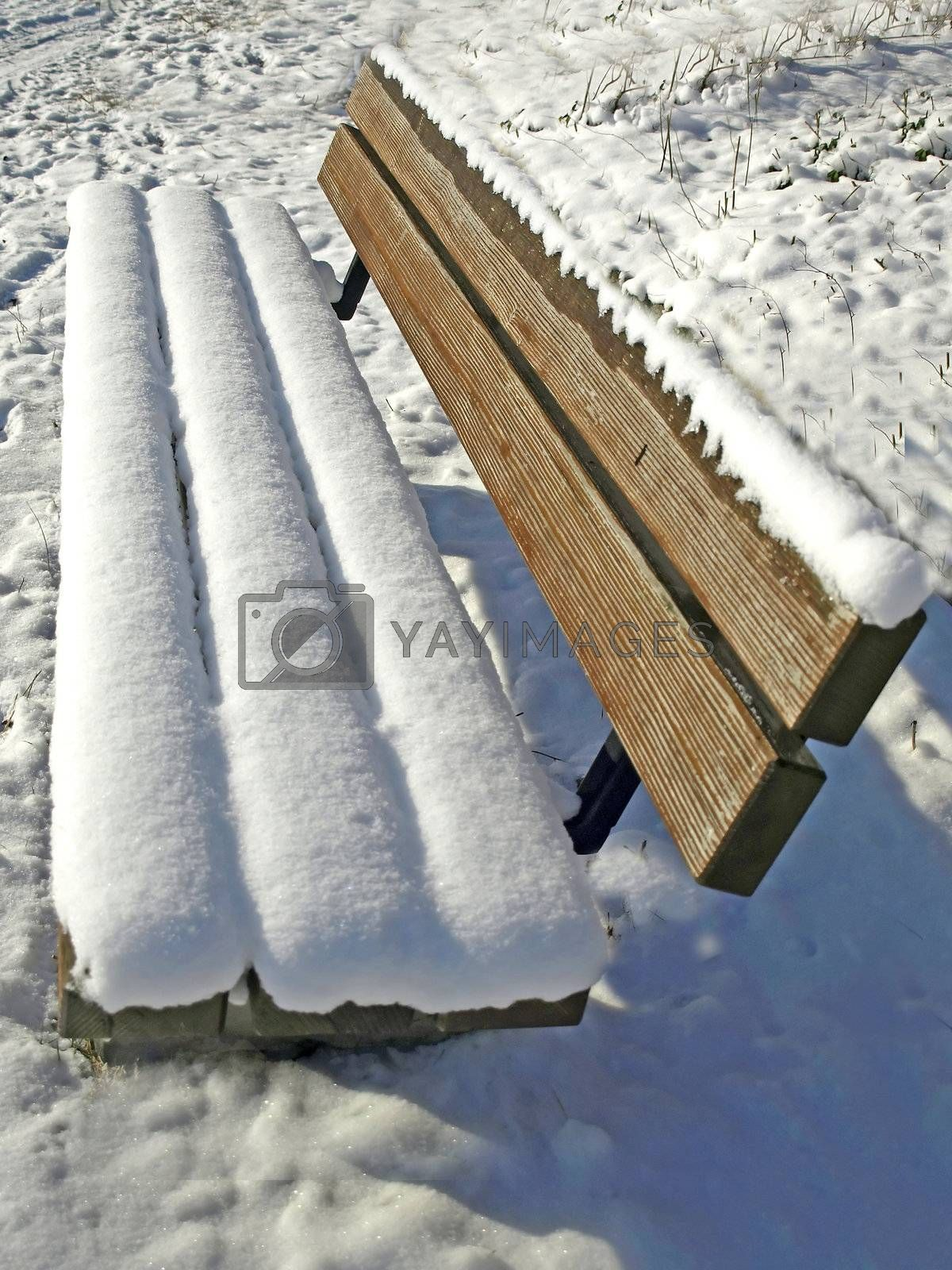 park bench with snow