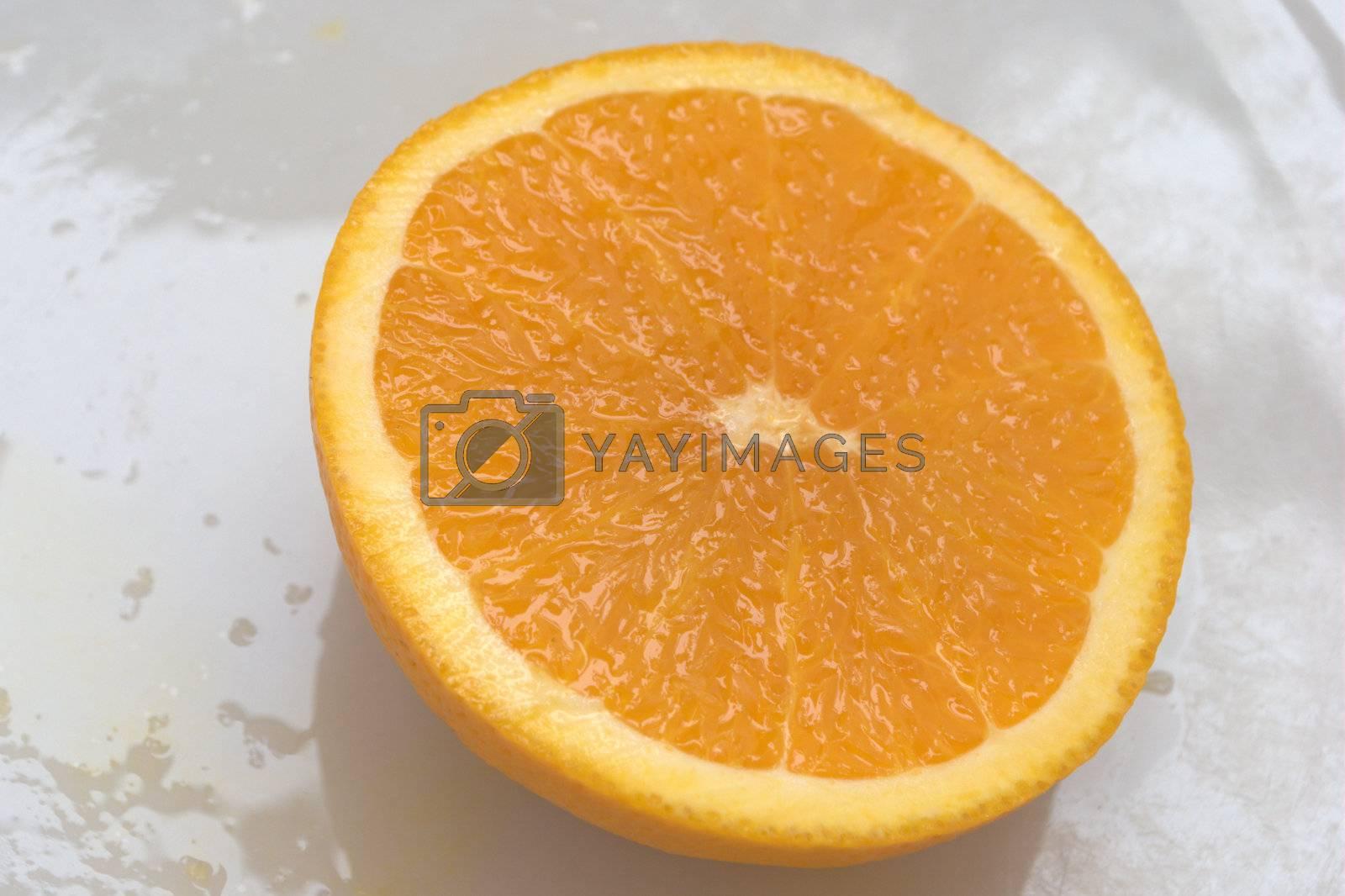 Sliced orange on white plate