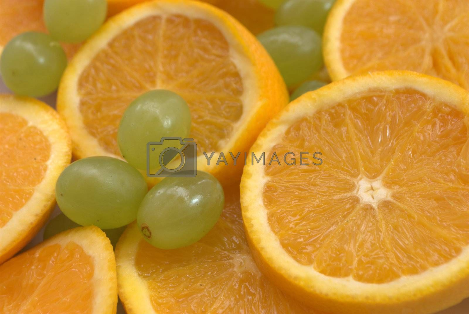 Slices of oranges and whole grapes