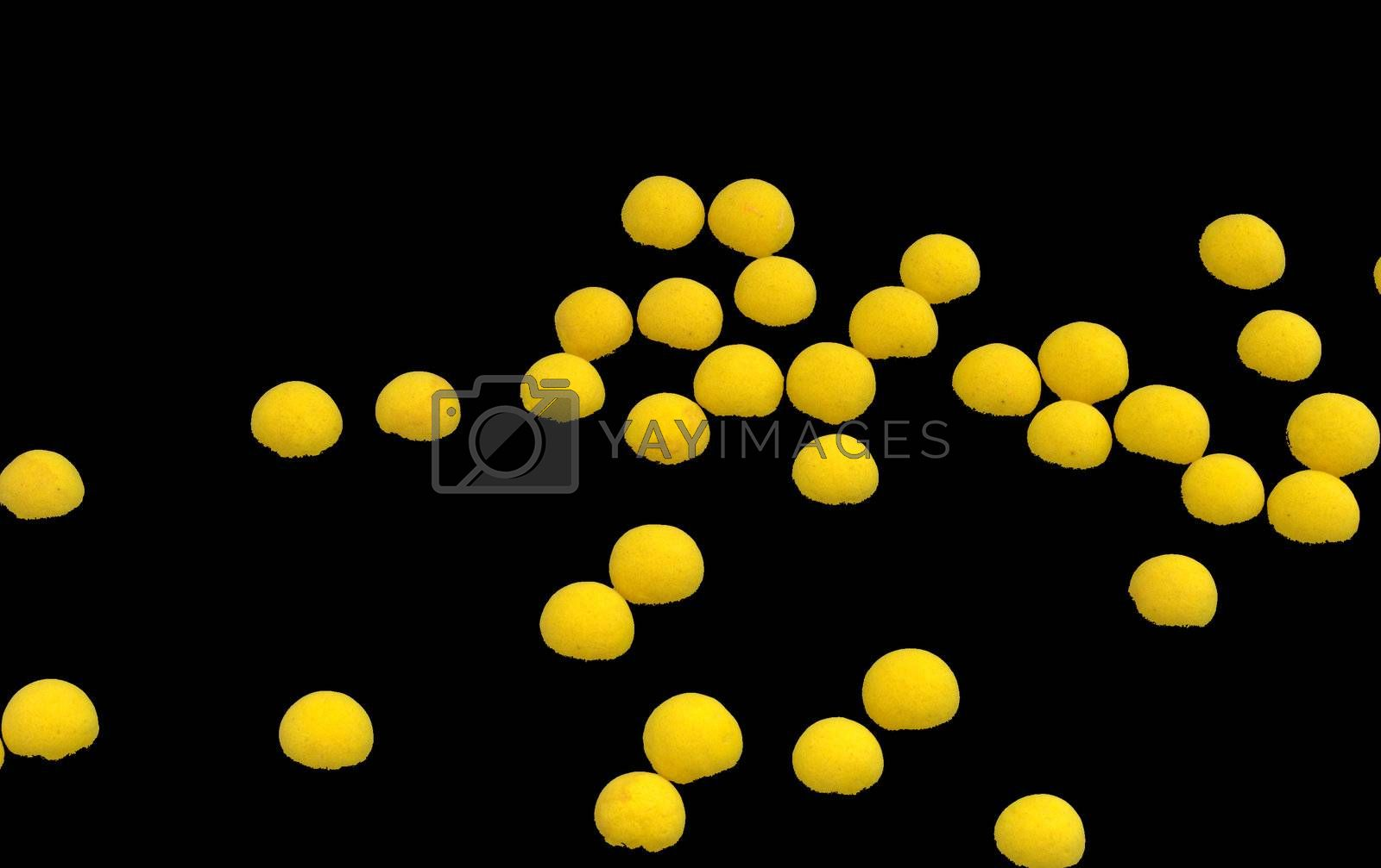 Group of bright yellow spheres on black background