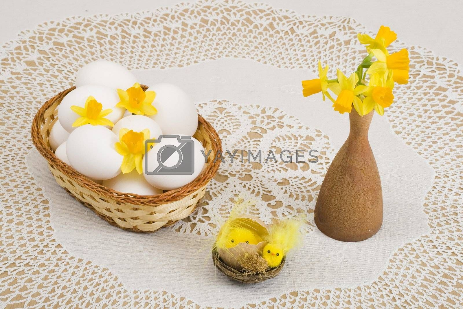 a basket of eggs, easter chicken and yellow daffodils