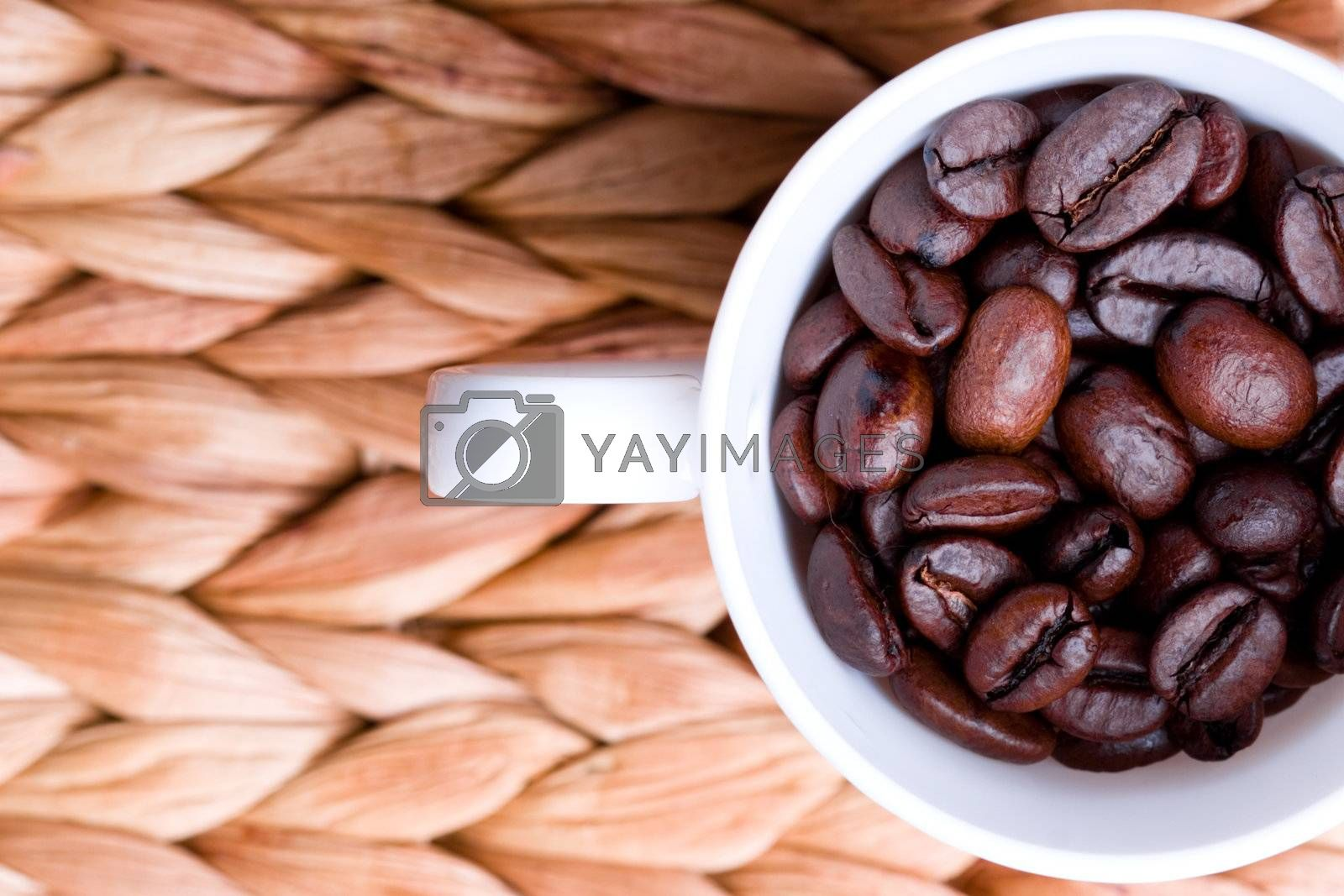 cup full of coffee beans by marylooo