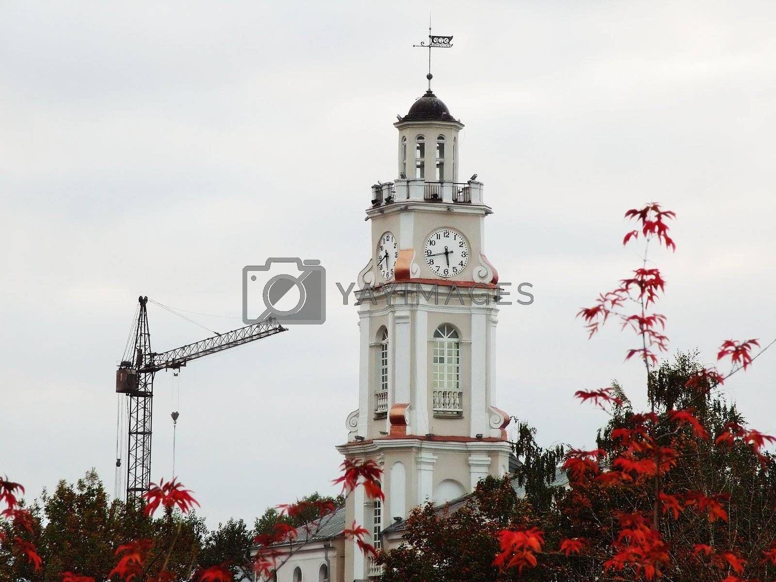City tower with clock, crane tower  and autumn trees - Vitebsk , Belarus