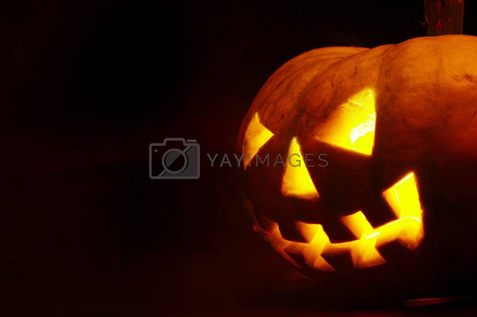 A scary old jack-o-lantern on black.