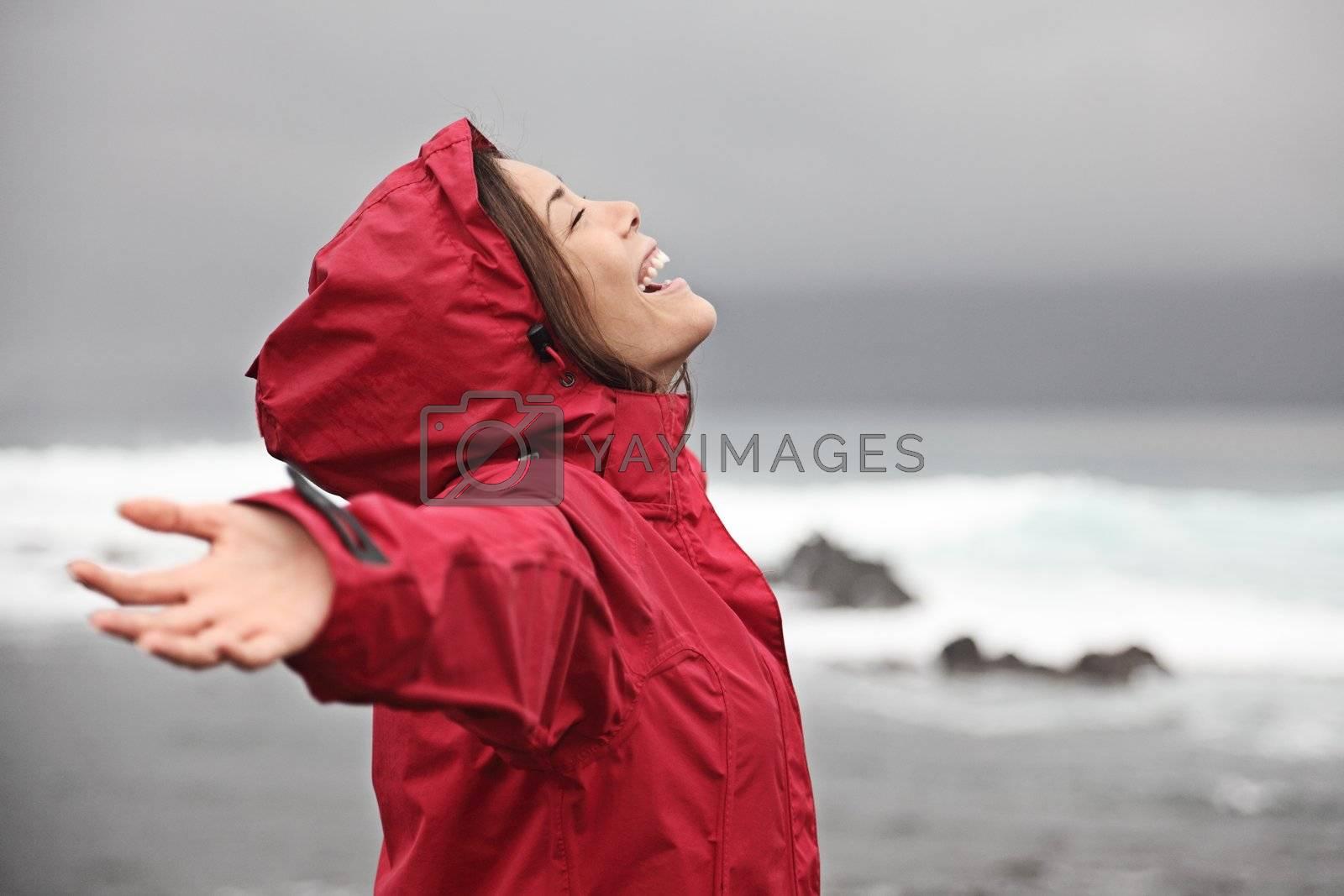 Woman enjoying rain weather by Maridav