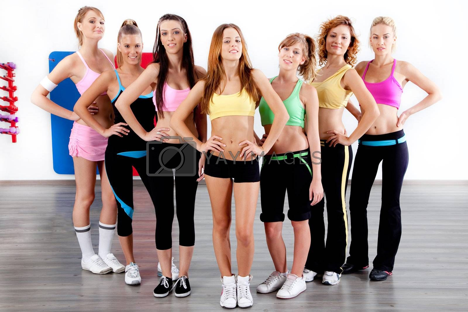image of fit women at gym posing for camera