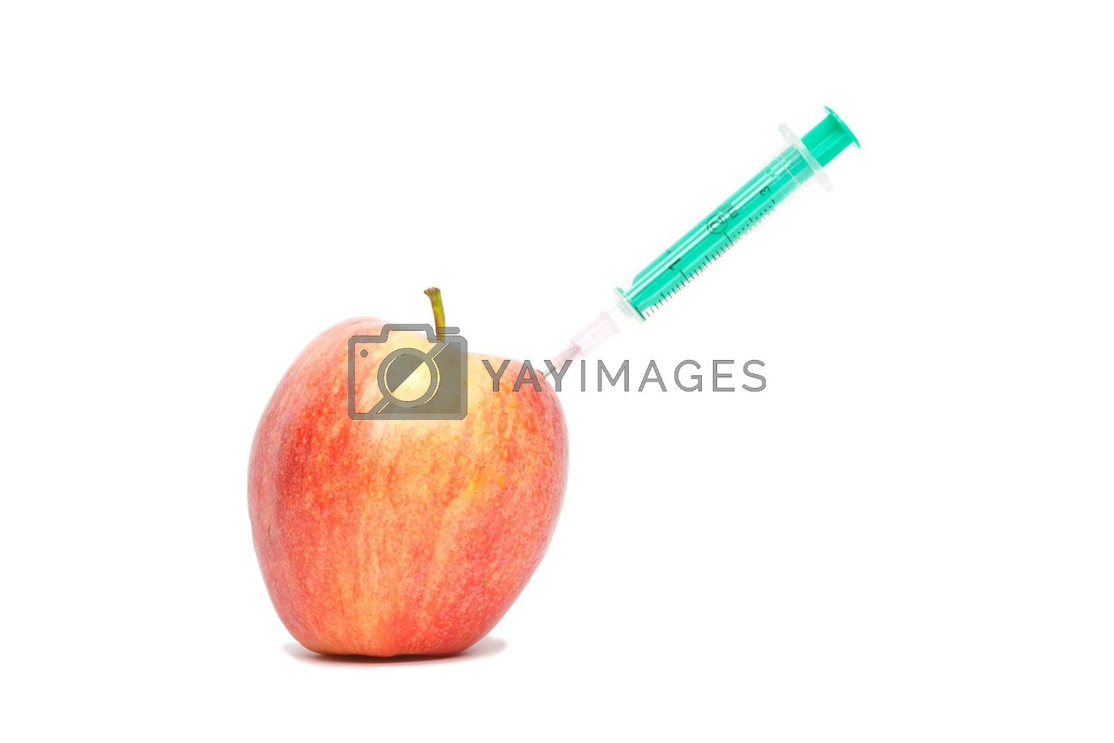 Red apple with a syringe on white background