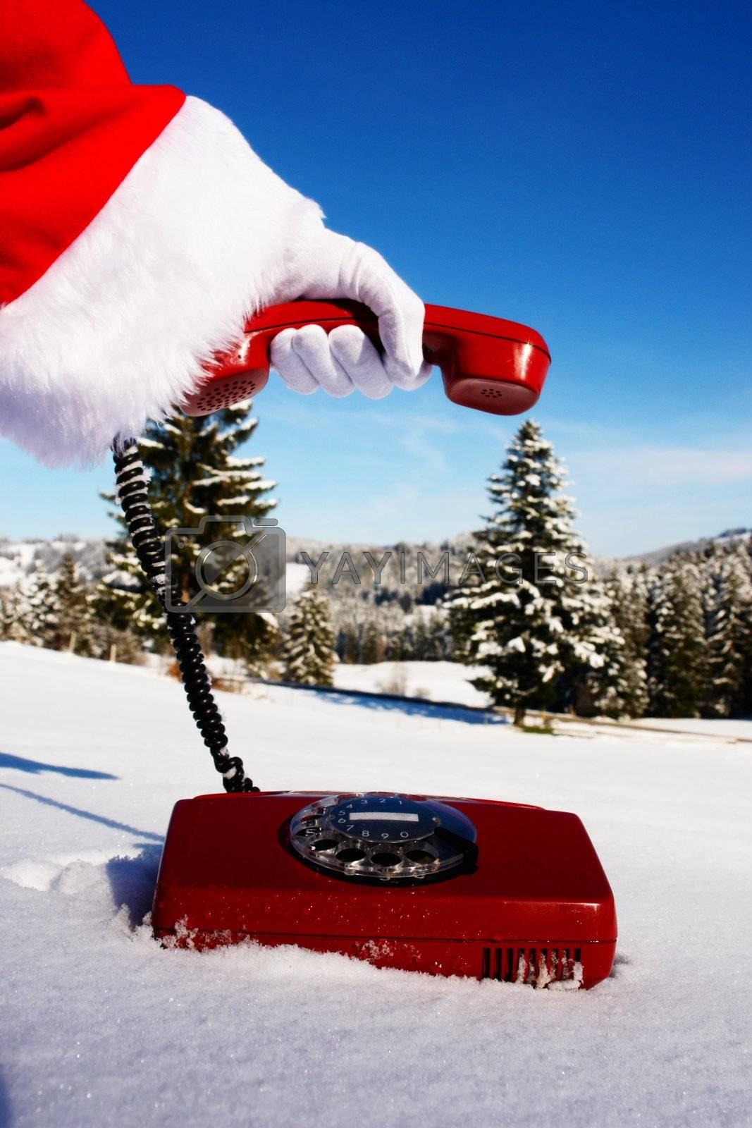 Santa Claus Hotline symbolized by a red retro phone...