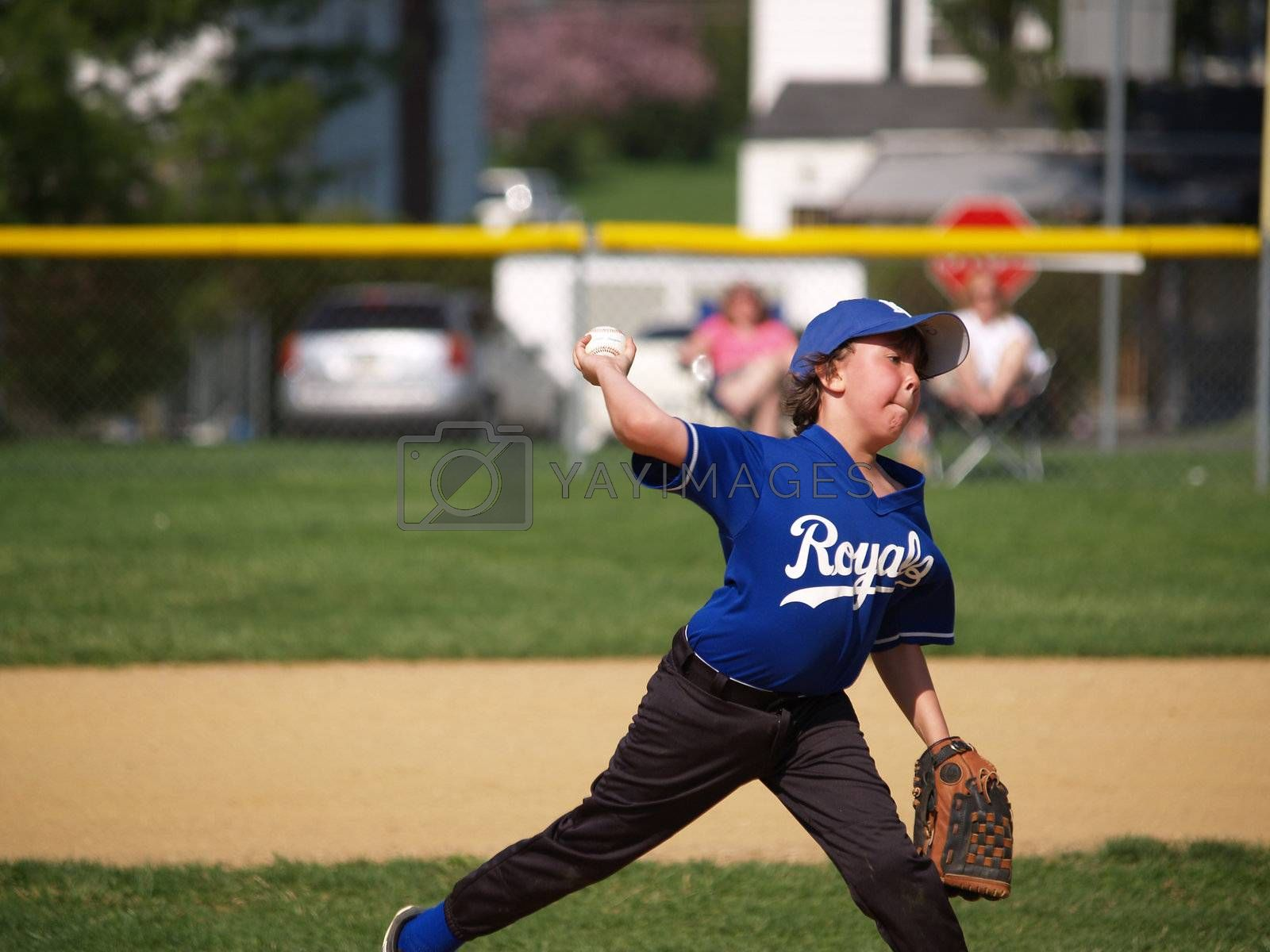 a determined little league baseball pitcher on the mound