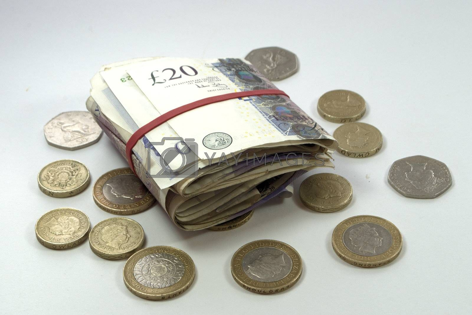 Bundle of twenty pound notes and coins