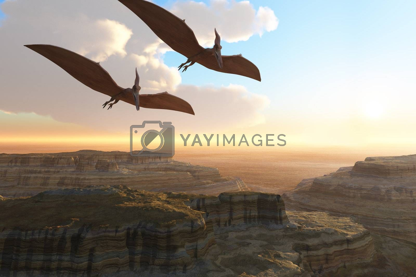 Two Pterodactyl flying dinosaurs soar above a beautiful canyon.
