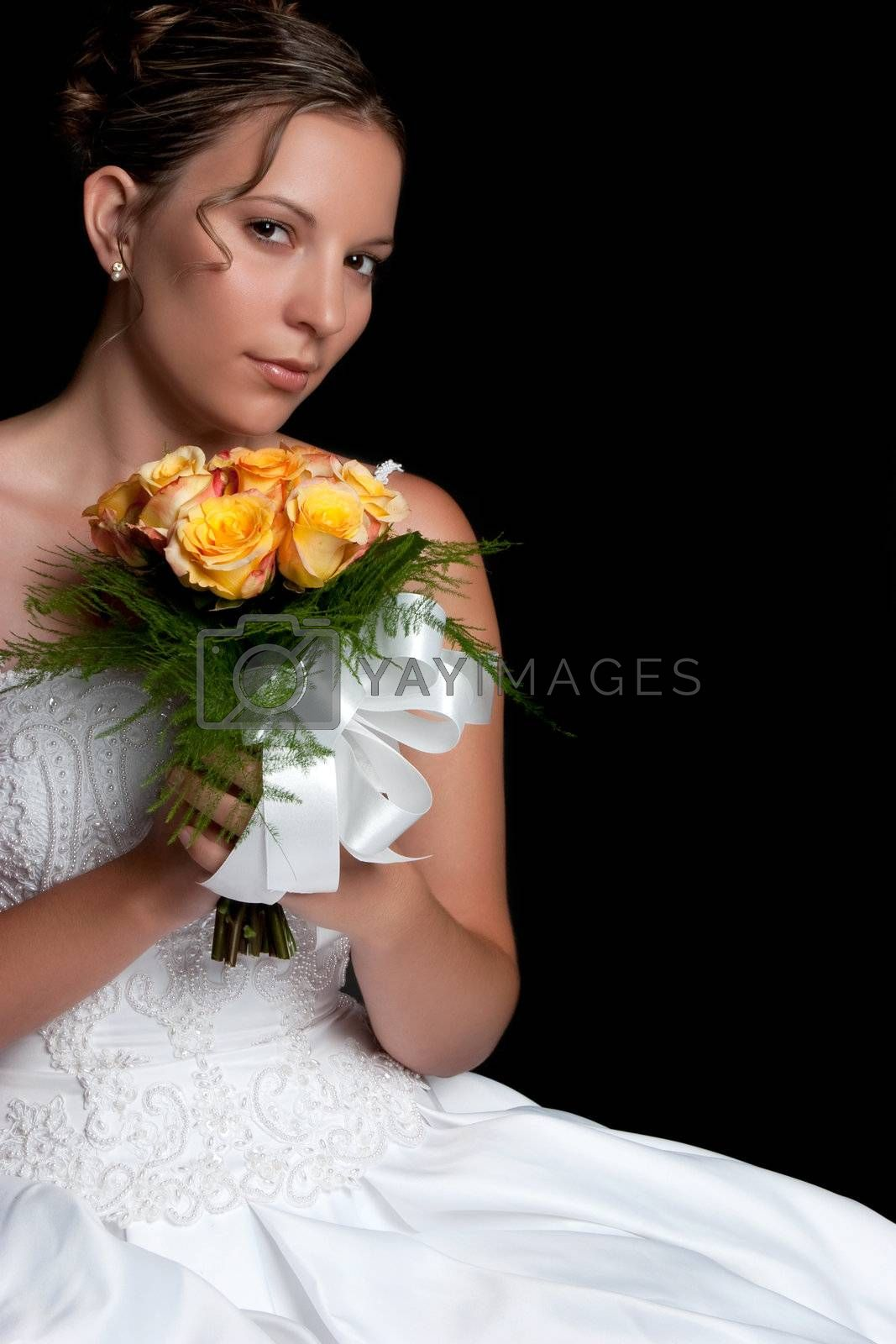 Beautiful young bride holding flowers