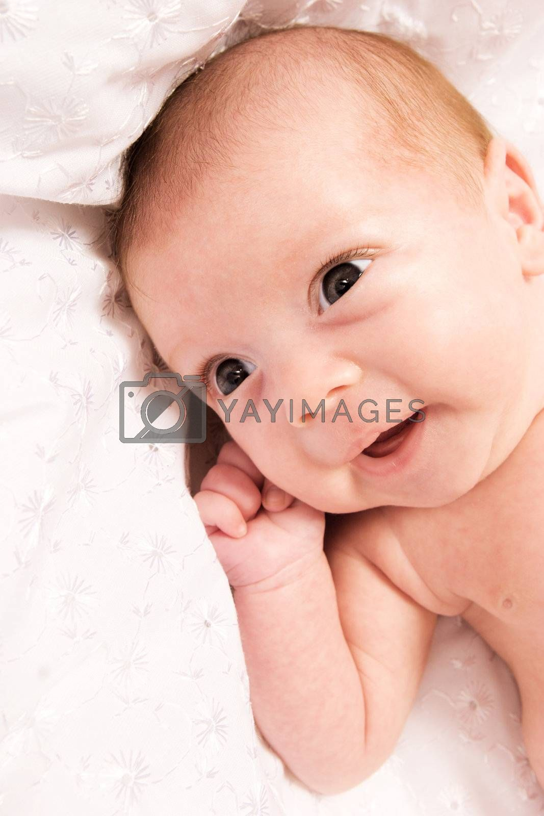 Baby girl in the age of one months isolated on white