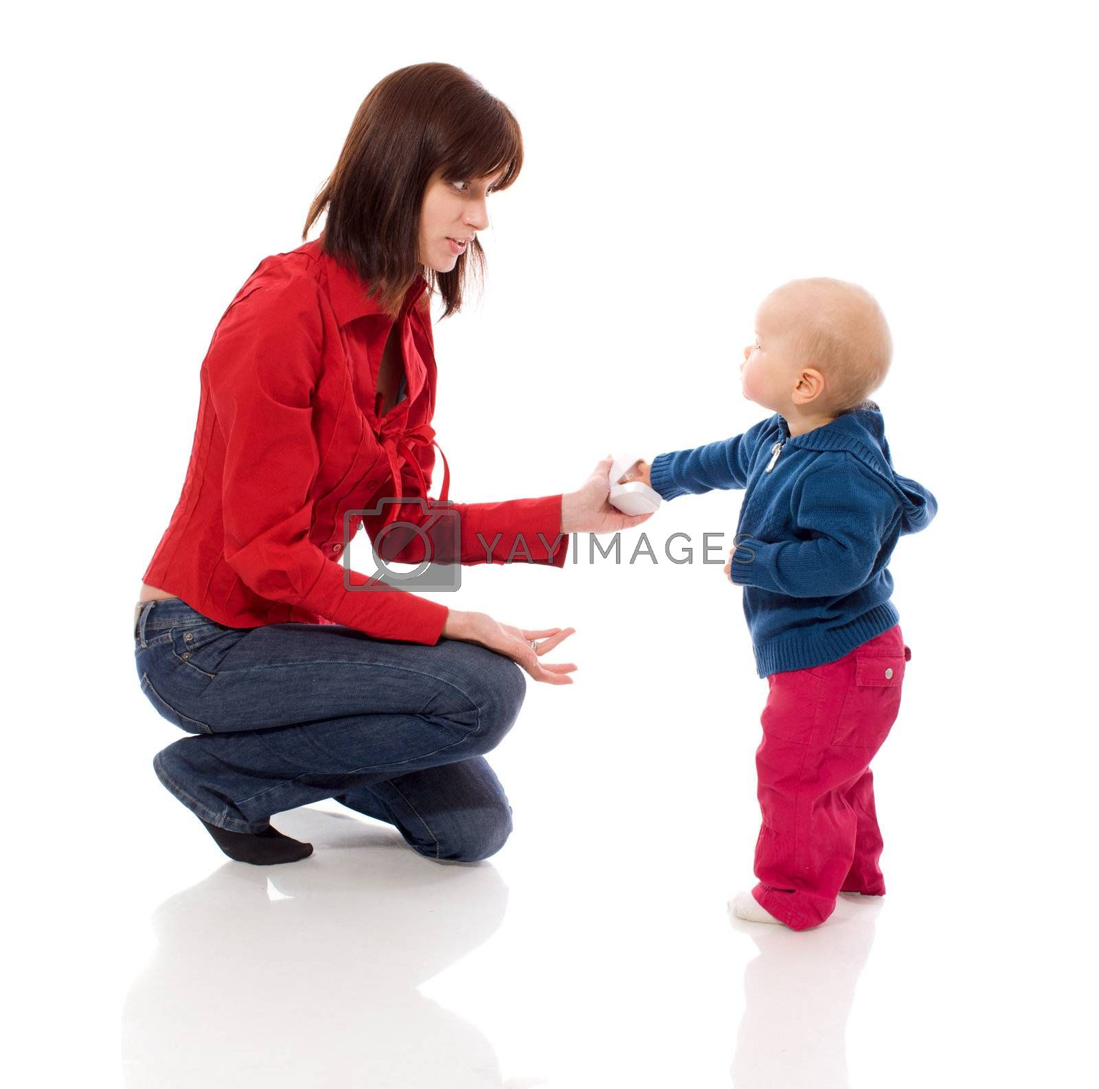 Toddler sharing toy with mother isolated on white