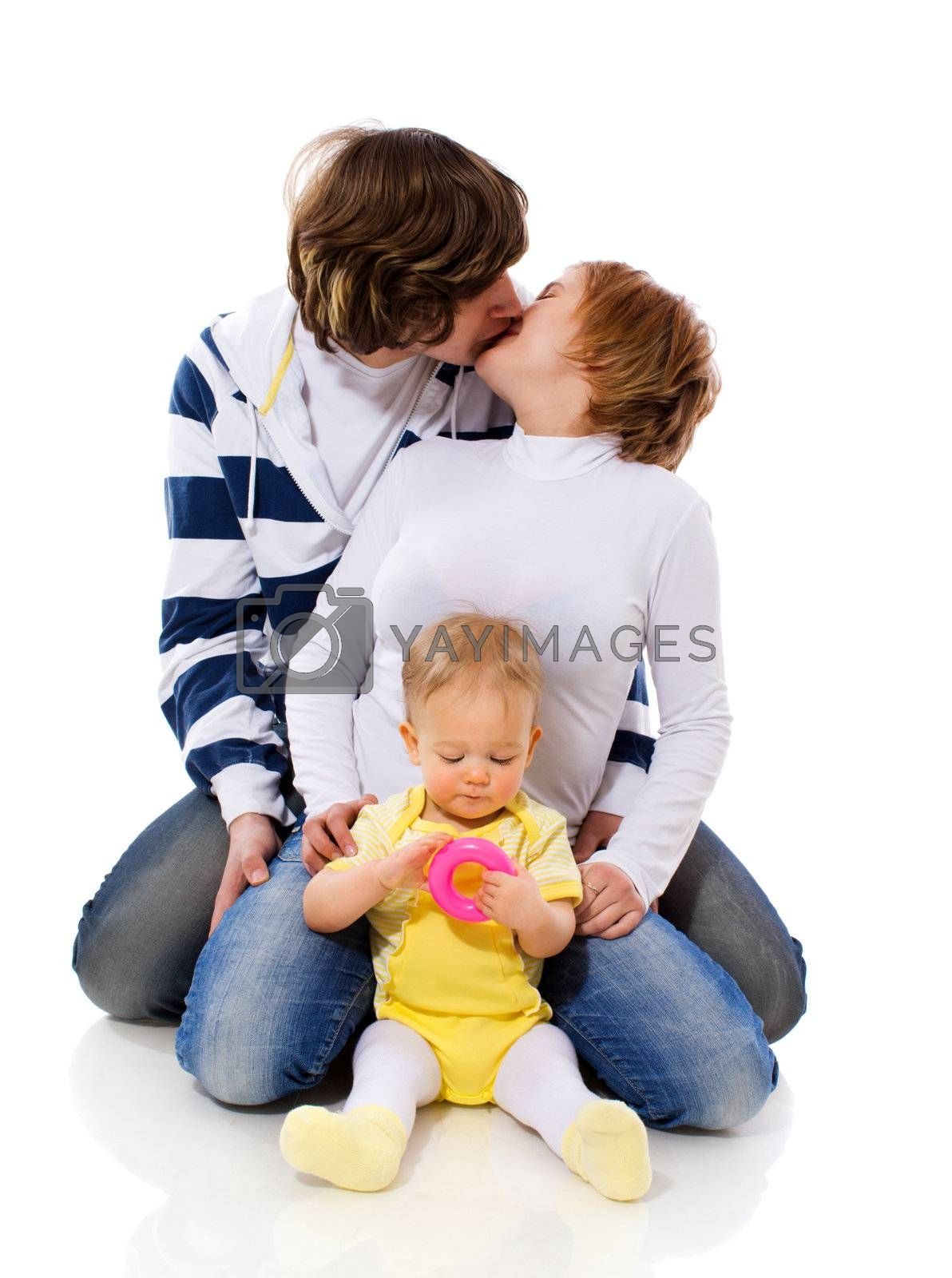 Happy Young Family with six month baby together isolated